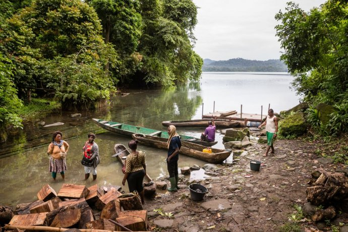 Photo of fishermen and women in water. Typical transmission site. Copyright M. Perkins