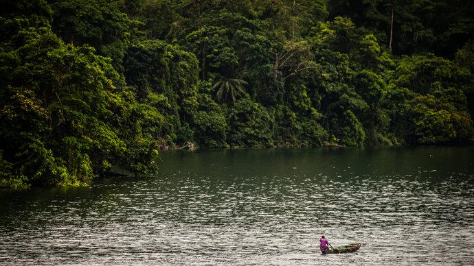 Bank of lake with a fishing canoe