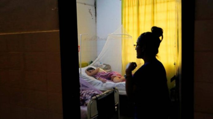 A patient infected with dengue rests while receiving treatment at a hospital in Asuncion, Paraguay January 16, 2020. REUTERS/Jorge Adorno