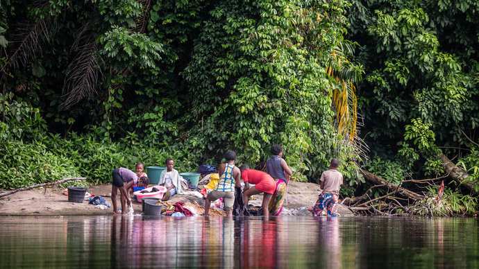 People washing and bathing in a natural lake. Image Credit Marcus Perkins and Merck KGaA