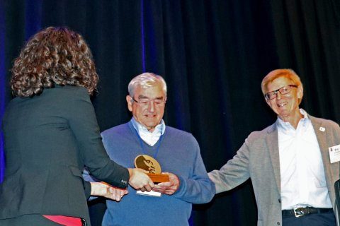 Professor Fenwick receiving the Kyelem Prize. Image copright COR NTD