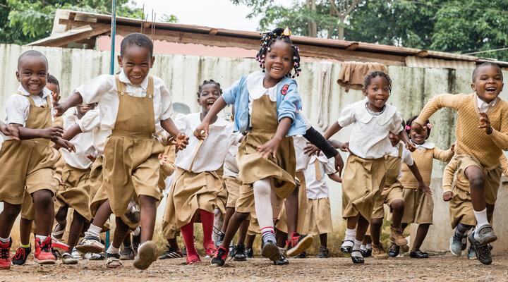 Happy, smiling children running towards the camera